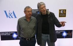 """Band members Nick Mason (L) and Roger Waters pose for photographers at a media event to promote """"The Pink Floyd Exhibition: Their Mortal Remains"""", which will open in May 2017,  in London, Britain, February 16, 2017. REUTERS/Neil Hall"""