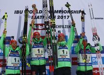 Biathlon - IBU World Championships - Women's 4 x 6km relay - Hochfilzen, Austria - 17/2/17 - Vanessa Hinz,  Maren Hammerschmidt, Franziska Hildebrand and  Laura Dahlmeier of Germany react.  REUTERS/Leonhard Foeger