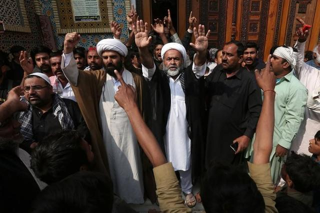Men and local religious leaders chant slogans as they protest to condemn Thursday's suicide blast at the tomb of Sufi saint Syed Usman Marwandi, also known as the Lal Shahbaz Qalandar shrine, in Sehwan Sharif, Pakistan's southern Sindh province, February 17, 2017. REUTERS/Akhtar Soomro