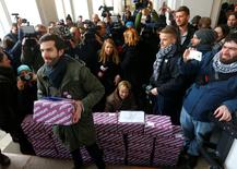 Andras Fekete-Gyor Leader of political movement Momentum holds up one of the boxes containing over 266,000 signatures of Budapest voters who want a referendum on Budapest's bid to host the 2024 Summer Olympics in Budapest, Hungary, February 17, 2017. REUTERS/Laszlo Balogh