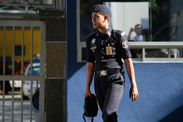 A police officer stands outside the morgue at Kuala Lumpur General Hospital where Kim Jong Nam's body is held for autopsy in Malaysia February 18, 2017. REUTERS/Athit Perawongmetha