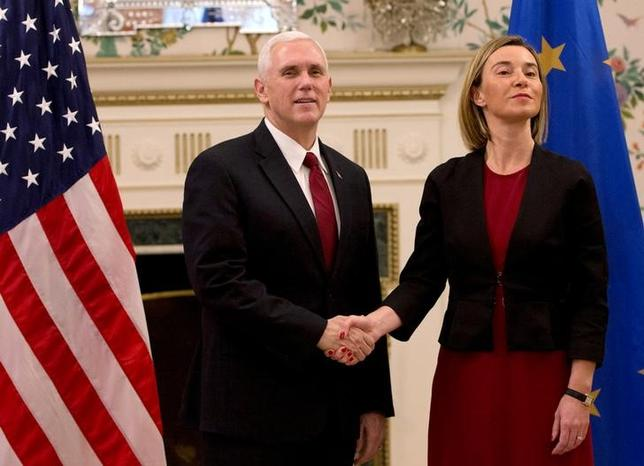 U.S. Vice President Mike Pence poses with European Union foreign policy chief Federica Mogherini in Brussels, Belgium, February 20, 2017. REUTERS/Virginia Mayo/Pool