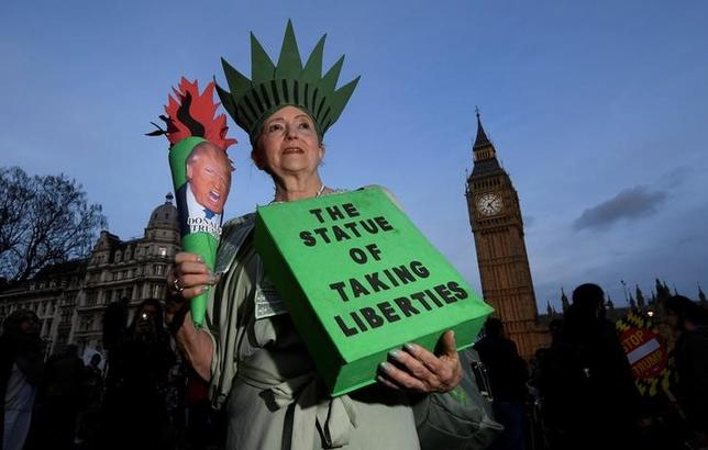A demonstrator dressed as the Statue of Liberty takes part in a protest against U.S. President Donald Trump in London, Britain February 20, 2017. REUTERS/Toby Melville