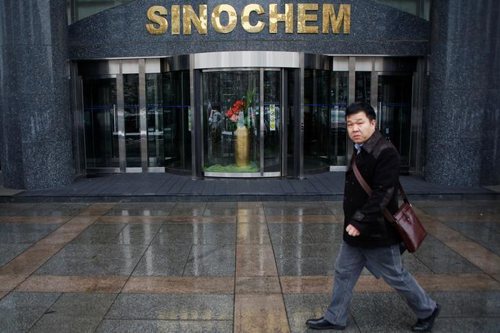 A man walks past the office building of Sinochem in Beijing, China February 21, 2017. REUTERS/Damir Sagolj