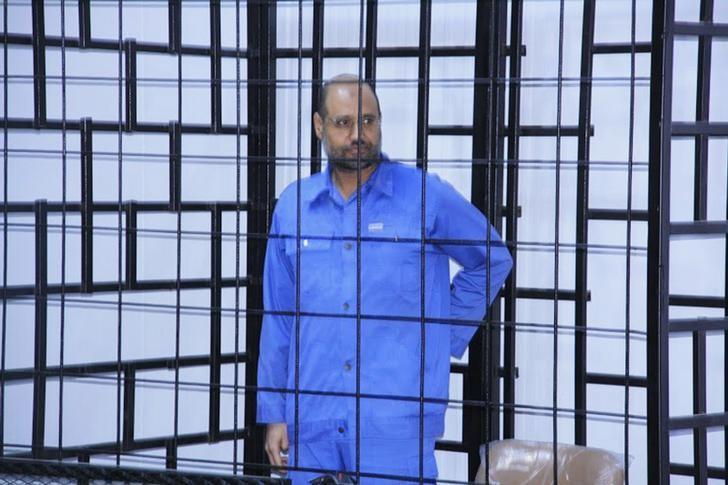 Saif al-Islam Gaddafi, son of late Libyan leader Muammar Gaddafi, attends a hearing behind bars in a courtroom in Zintan, June 22, 2014 . REUTERS/Stringer/File Photo