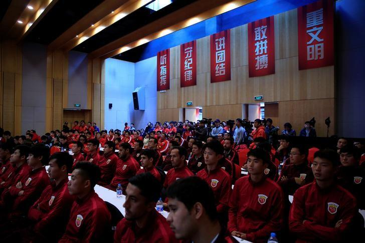 Soccer players attend the 2017 SIPG Football Club's season mobilization of the Chinese Super League, in Shanghai, China February 13, 2017. REUTERS/Aly Song