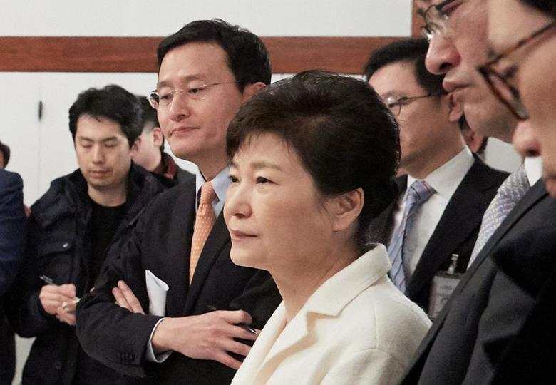 South Korean President Park Geun-hye listens to a reporter's question during a meeting with reporters at the Presidential Blue House in Seoul, South Korea, in this handout picture provided by the Presidential Blue House and released by Yonhap on January 1, 2017.    Blue House/Yonhap via REUTERS
