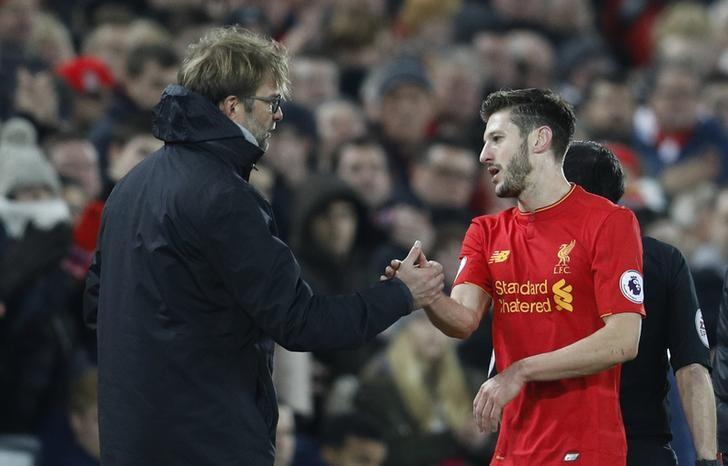Britain Football Soccer - Liverpool v Stoke City - Premier League - Anfield - 27/12/16 Liverpool manager Juergen Klopp with Adam Lallana as he is substituted  Reuters / Darren Staples