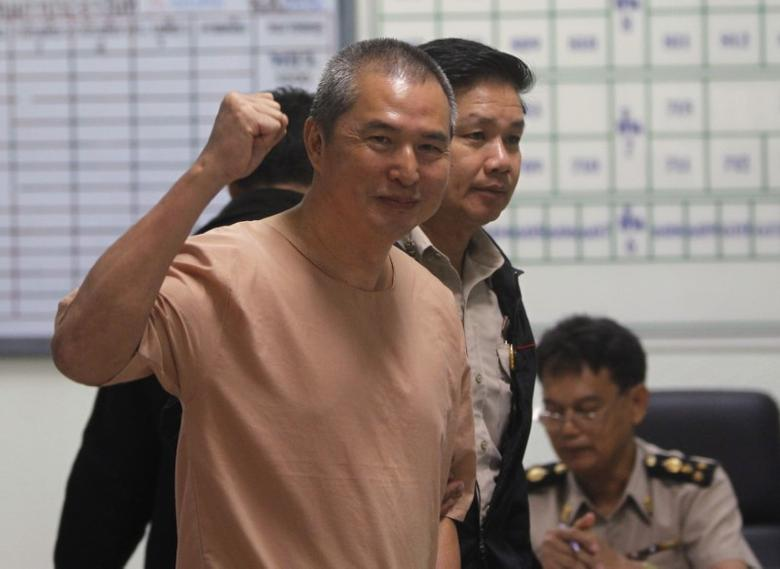 Somyot Prueksakasemsuk, editor of ''Voice of the Oppressed'', a magazine devoted to self-exiled former Prime Minister Thaksin Shinawatra, gestures as he walks near a prison cell at the criminal court in Bangkok January 23, 2013. REUTERS/Chaiwat Subprasom/Files
