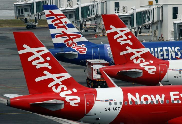 AirAsia planes sit on the tarmac at Kuala Lumpur International Airport, Malaysia August 28, 2016. REUTERS/Edgar Su/Files