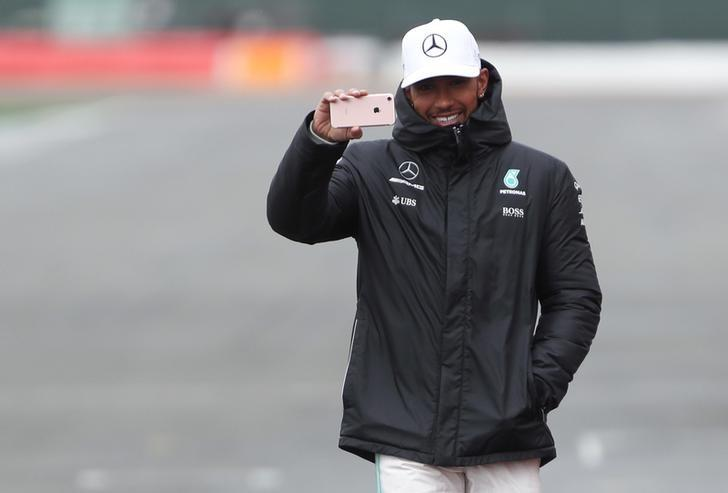 Britain Formula One - F1 - 2017 Mercedes Formula One Car Launch - Silverstone - 23/2/17 Mercedes' Lewis Hamilton uses his mobile phone during the launch Reuters / Eddie Keogh Livepic