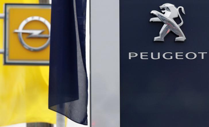The logos of French car maker Peugeot and German car maker Opel are seen at a dealership in Villepinte, near Paris, France, February 20, 2017.   REUTERS/Christian Hartmann/Files