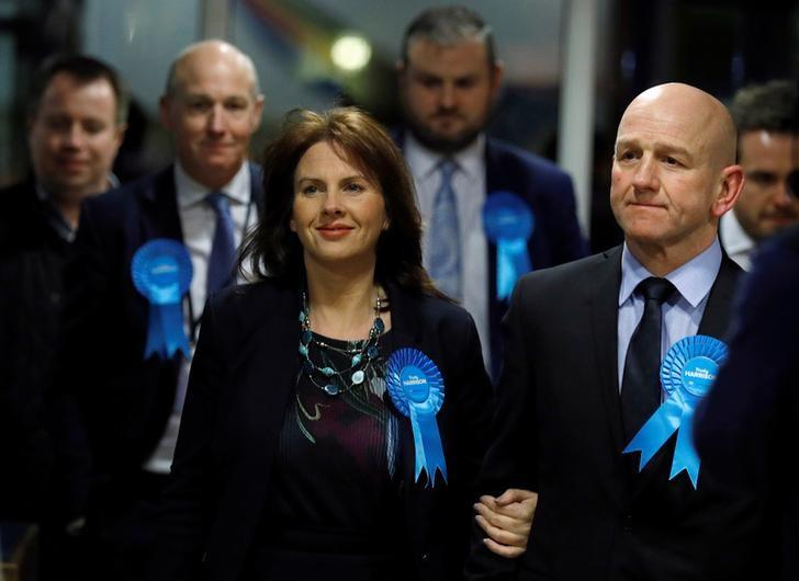 Conservative Party candidate Trudy Harrison (C) arrives with her husband Keith at the count for the Copeland by-election in Whitehaven, Britain, February 24, 2017. REUTERS/Phil Noble