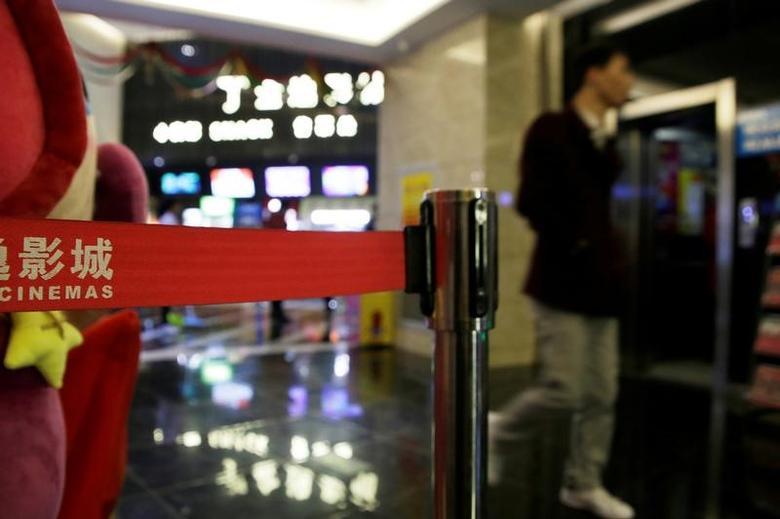 A man walks inside a cinema in Tianjin, China, January 13, 2017. REUTERS/Jason Lee/File Photo