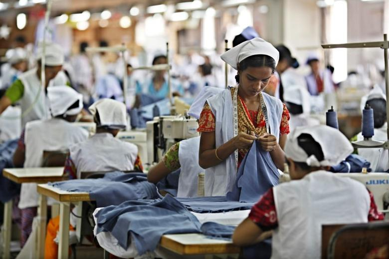 Joli Khatun (R) works in a garment factory in Gazipur May 11, 2010. Joli works for 4-hour extra everyday as overtime and earns about 4,000 taka ($57) as her salary per month. REUTERS/Andrew Biraj