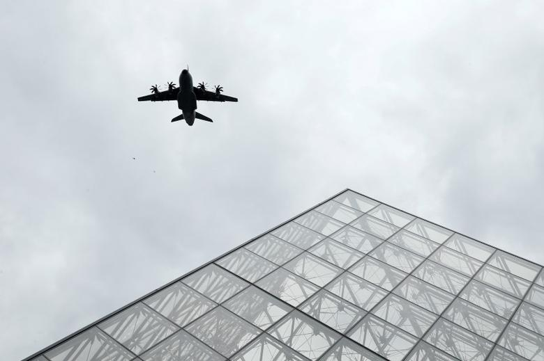 An Airbus A400M fly over the Pyramid of the Louvre Museum as part of a rehearsal of the traditional Bastille Day military parade in Paris, France, July 11, 2016.   REUTERS/Benoit Tessier/Files