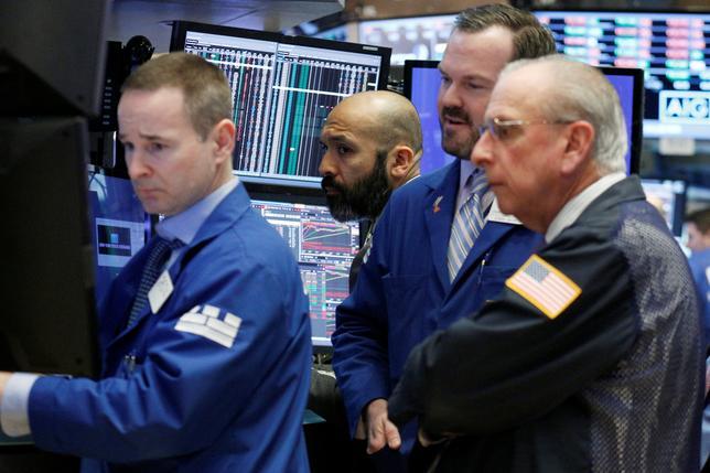 Traders work on the floor of the New York Stock Exchange (NYSE) in New York, U.S., February 22, 2017. REUTERS/Brendan McDermid