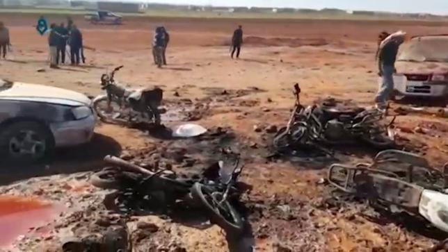 A still image taken from a video posted on social media uploaded on February 24, 2017, shows people inspecting the damage at a site of an Islamic State car bomb explosion, said to be in Sousian village near al-Bab, Syria. Social Media