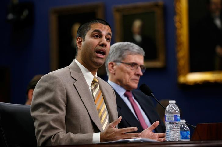 Federal Communications Commission (FCC) Commissioner Ajit Pai (L) and FCC Chairman Tom Wheeler testify at a House Appropriations Financial Services and General Government Subcommittee hearing on the FCC's FY2016 budget, on Capitol Hill in Washington March 24, 2015. REUTERS/Kevin Lamarque/File Photo