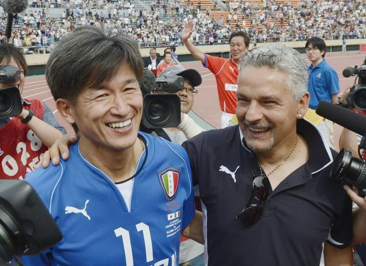 Former Italy striker Roberto Baggio (R) who participated as coach of the Italian legends Glorie Azzurre team, talks with Kazuyoshi Miura, J-League soccer player who participated in both J-League Legend and played for the Italian team for this game, after their exhibition match at the National Stadium in Tokyo June 9, 2013.  Mandatory Credit. REUTERS/Kyodo/File Photo