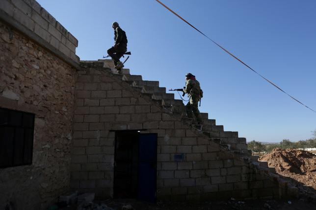 FILE PHOTO: Rebel fighters carry their weapons as they climb a staircase on the outskirts of Al-Bab town in Syria January 22, 2017. REUTERS/Khalil Ashawi/File Photo
