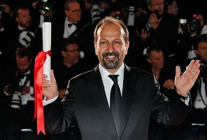 Director Asghar Farhadi, Best screenplay award winner for his film ''Forushande'' (The Salesman), poses during a photocall after the closing ceremony at the 69th Cannes Film Festival in Cannes, France, May 22, 2016.    REUTERS/Regis Duvignau