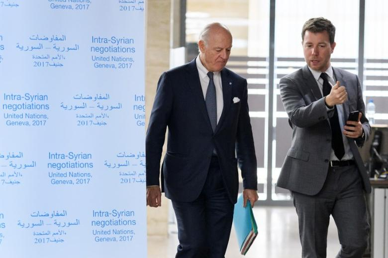 U.N. Special Envoy for Syria Staffan de Mistura (L) arrives for a meeting during Syria peace talks in Geneva, Switzerland, February 27, 2017. REUTERS/ Fabrice Coffrini/Pool