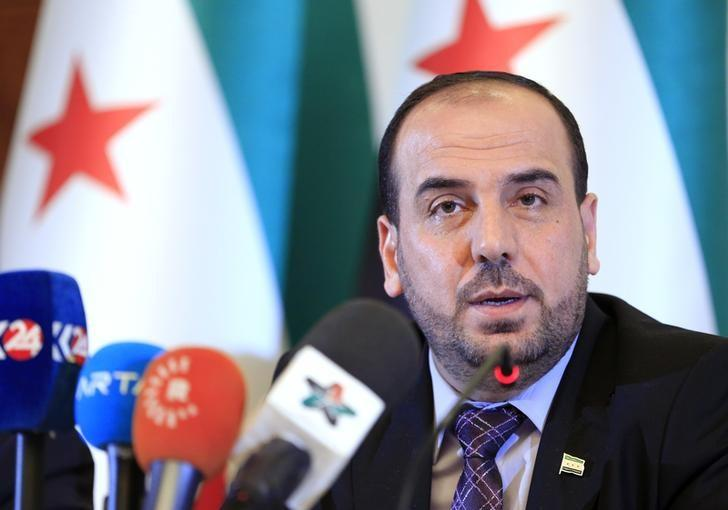 Head of the Syrian High Negotiations Committee (HNC) opposition group Nasr al-Hariri addresses the media aside of the Intra-Syria peace talks in Geneva, Switzerland, February 25, 2017. REUTERS/Pierre Albouy