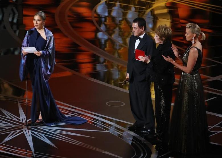 89th Academy Awards - Oscars Awards Show - Hollywood, California, U.S. - 26/02/17 - Best Foreign Language Film The Salesman Asghar Farhadi (Iran) is accepted by a designated woman reading Farhadi's statement. REUTERS/Lucy Nicholson