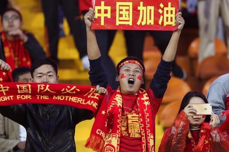 Football Soccer - China v Syria - 2018 World Cup Qualifying Asia Zone - Round 3 Group A - Xi'an, China - 6/10/16    Fans cheer ahead of the match between China and Syria. The Chinese characters read, ''China fighting''. REUTERS/Stringer