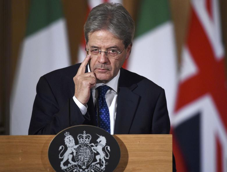 Italy's Prime Minister Paolo Gentiloni holds a press conference with his counterpart from Britain Theresa May (not shown) at Number 10 Downing Street in London, February 9, 2017. REUTERS/Facundo Arrizabalaga/Pool
