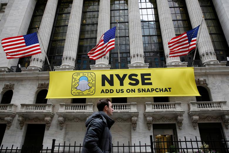 A Snapchat sign hangs on the facade of the New York Stock Exchange (NYSE) in New York City, U.S., January 23, 2017. REUTERS/Brendan McDermid/File Photo