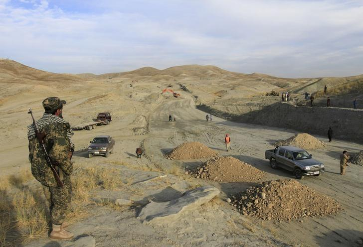 An Afghan security personnel keeps watch at a road construction site, which is being built by a Chinese company, in Khogyani district of Nangarhar province November 19, 2015. REUTERS/Parwiz/Files