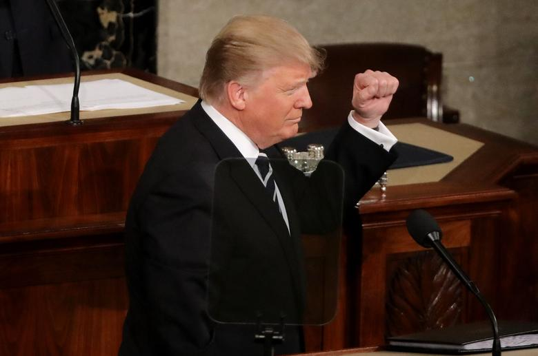 U.S. President Donald Trump pumps his fist as he addresses Congress. REUTERS/Carlos Barria