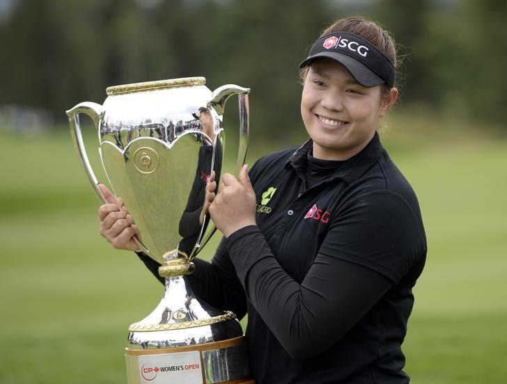 FILE PHOTO - Aug 28, 2016; Calgary, Alberta, CAN; Ariya Jutanugarn of Thailand poses with the championship trophy after winning the Canadian Pacific Women's Open at Priddis Greens Golf and Country Club. Photo taken August 28, 2016. Mandatory Credit: Eric Bolte-USA TODAY Sports