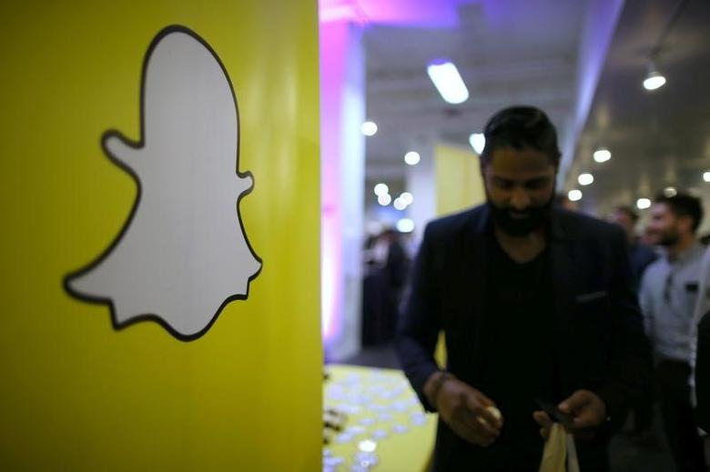 FILE PHOTO: The logo of messaging app Snapchat is seen at a booth at TechFair LA, a technology job fair, in Los Angeles, California, U.S., January 26, 2017.  REUTERS/Lucy Nicholson/File Photo