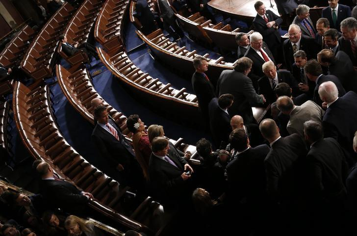 U.S. President Trump addresses Joint Session of Congress - Washington, U.S. - 28/02/17 - U.S. President Donald Trump (Center, R) shakes hands with Republicans who stayed after his speech as seats occupied by Democratic members lie empty. REUTERS/Jonathan Ernst