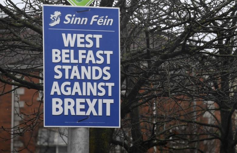 An election campaign poster is seen in the Falls Road area of west Belfast, Northern Ireland, February 28, 2017. REUTERS/Toby Melville - RTS10R57