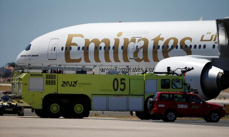 An Emirates plane is seen next to fire truck at Lisbon's airport, Portugal June 24, 2016. REUTERS/Rafael Marchante/Files