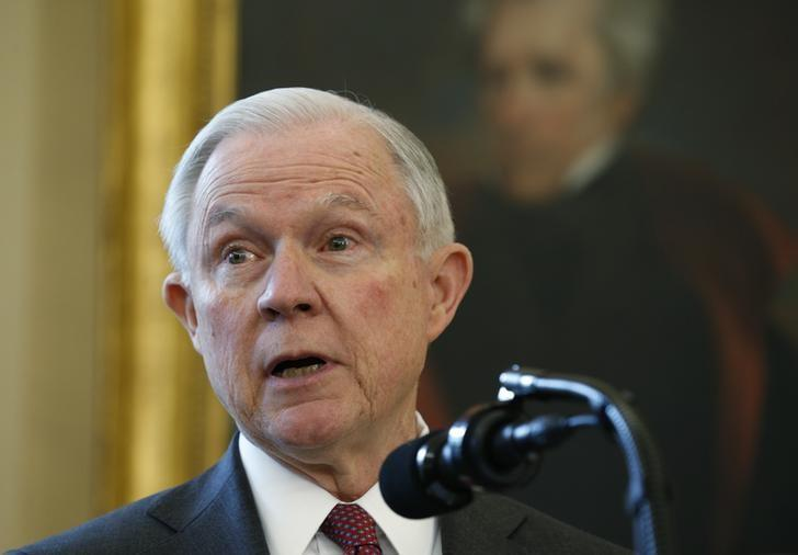 New U.S. Attorney General Jeff Sessions speaks in front of a portrait of former U.S. President Andrew Jackson after being sworn-in in the Oval Office of the White House in Washington, U.S., February 9, 2017.  REUTERS/Kevin Lamarque