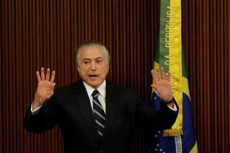 Brazil's President Michel Temer gestures during a meeting with the Pension Reform Commission at the Planalto Palace in Brasilia, Brazil, February 21, 2017. REUTERS/Ueslei Marcelino - RTSZNW4