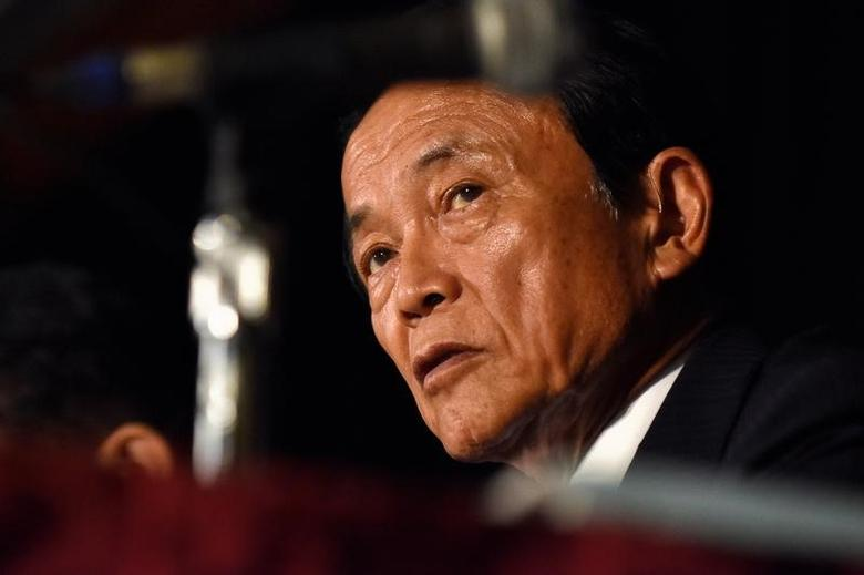 FILE PHOTO: Japanese Finance Minister Taro Aso takes questions from reporters at the annual meetings of the IMF and World Bank Group in Washington October 7, 2016. REUTERS/James Lawler Duggan