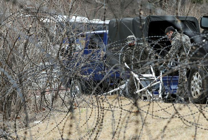 A barbed-wire fence is set up around a golf course owned by Lotte, where the U.S. Terminal High Altitude Area Defense (THAAD) system will be deployed, in Seongju, South Korea, March 1, 2017.   Kim Joon-beom/Yonhap