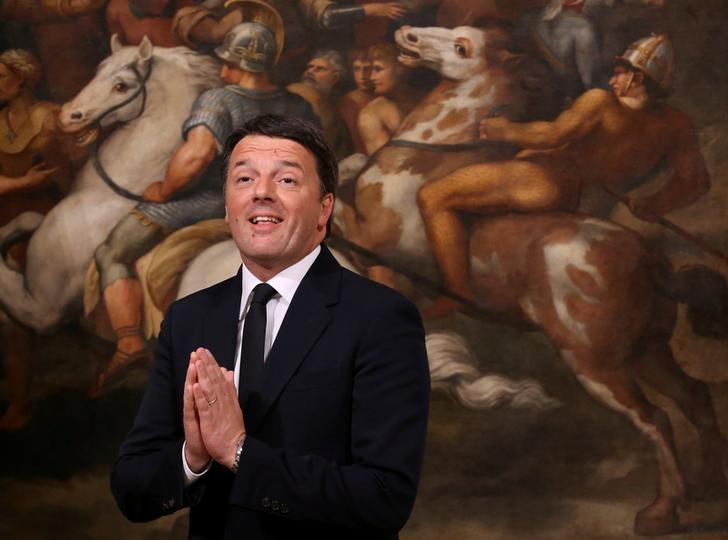 Matteo Renzi gestures during the bell ceremony, to signify the start of the first cabinet meeting of the newly appointed Italian Prime Minister Paolo Gentiloni, at Chigi Palace in Rome, Italy December 12, 2016. REUTERS/Alessandro Bianchi/Files