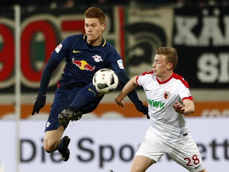 Football Soccer - FC Augsburg v RB Leipzig - German Bundesliga - WWK Arena, Augsburg, Germany- 3/3/17 - Leipzig's Marcel Halstenberg in action with Augsburg's Georg Teigl. REUTERS/Michaela Rehle
