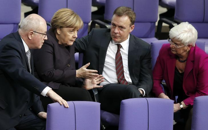 German Chancellor Angela Merkel (2nd L) speaks with parliamentary faction leaders Volker Kauder (L-R) of the Christian Democratic Union (CDU), Thomas Oppermann of the Social Democratic Party (SPD) and chairwoman of the parliamentary state group of the Christian Social Union party (CSU) Gerda Hasselfeldt during a session of the German lower house of parliament, the Bundestag, in Berlin, Germany, November 25, 2015.   REUTERS/Fabrizio Bensch/Files
