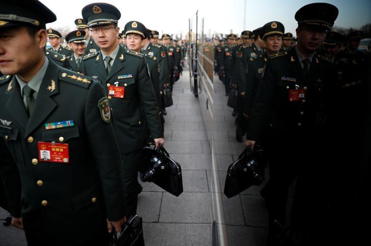 Military delegates arrive at the Tiananmen Square outside the Great Hall of the People for the opening session of the National People's Congress (NPC) in Beijing, China, March 5, 2017. REUTERS/Damir Sagolj/Files