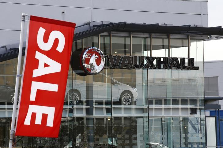 A Vauxhall dealership advertises a sale on its vehicles near the Vauxhall plant in Luton, Britain February 17, 2017.  REUTERS/Peter Cziborra/Files