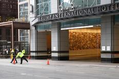 Toronto police place construction cones to close off streets surrounding Trump International Hotel and Tower in Toronto, Ontario early March 24, 2012 after glass panels fell off the building that is under construction on upper floors. REUTERS/Hyungwon Kang