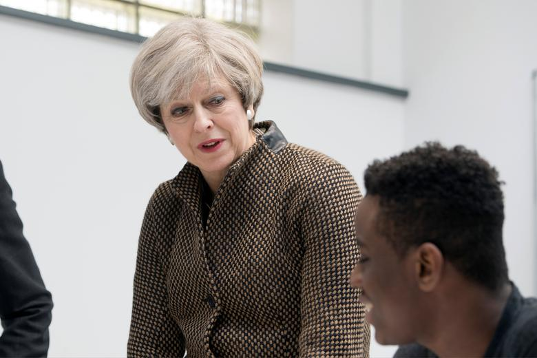 Britain's Prime Minister Theresa May talks with Head Teacher Dan Abramson and student Charles Kanda in a mathematics class during a visit to King's College London Mathematics School in central London March 6, 2017. REUTERS/Victoria Jones/Pool